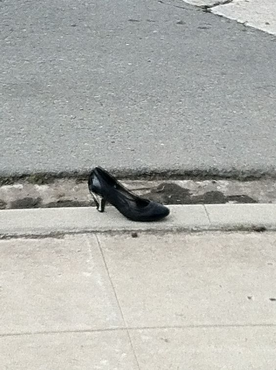 Random shoe on the curb