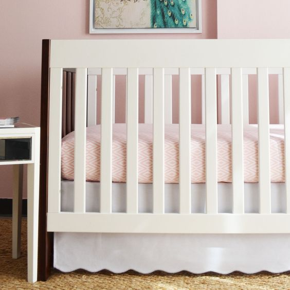 White Scalloped Crib Skirt with Silver Trim - This crib skirt is a great neutral to go with any bedding, but doesn't lack style with the darling scallop detail.