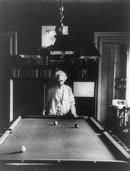 Mark Twain taking his billiards game very, very seriously.