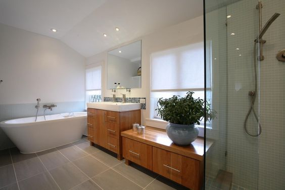 Elegant Small Bathroom Renovation Pictures With White Wall And Freestanding Soaking Bathtub