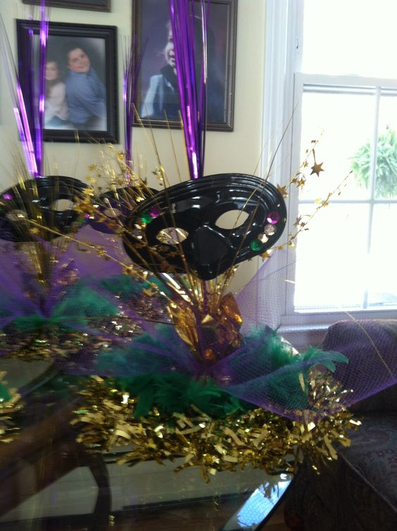 Mardi gras centerpiece made with gold tinsel wreath from