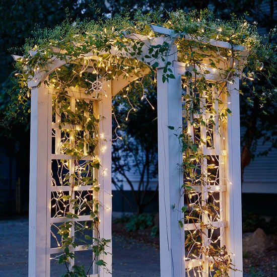 lighted trellis use greenery and strands of lights for an all year lighting