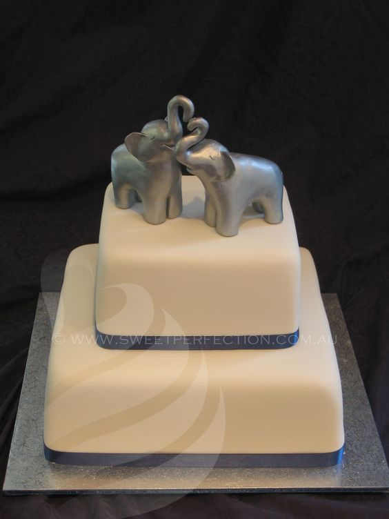 Simple two-tiered cake with custom hand-moulded elephant topper. 2012.