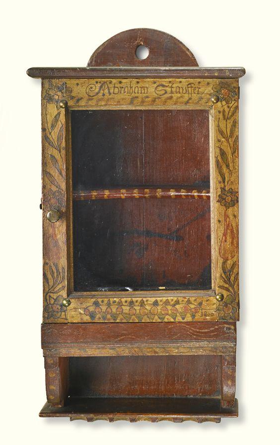 Esmerian collection. Sotheby's. 1/25/14. Lot 527. PAINTED PINE HANGING CUPBOARD WITH SPOON SHELF, ATTRIBUTED TO JOHN DRISSEL (ACT. 1790-1835).  MILFORD TOWNSHIP, BUCKS COUNTY, PENNSYLVANIA, DATED 1800. Inscribed door front, paint: Abraham Stauffer / 1800. 19 by 10 by 5 3/8 in. Estimate 80,000 — 120,000 USD  LOT SOLD. 209,000 USD  (Hammer Price with Buyer's Premium)