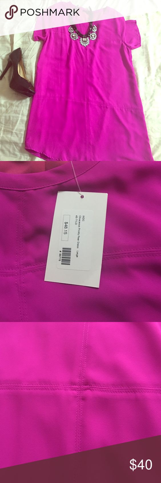Dress A beautiful dress true magenta in color, shift style, pull over. About 33 inch long. Really beautiful dress that could be added to your wardrobe. It fit to small, because my hips don't lie Dresses Mini