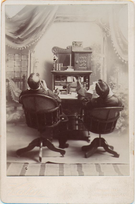 https://flic.kr/p/4Divm1 | Two Men at a Desk - Cabinet Card | This cabinet card by Kalin of Clay Center, Kansas shows two men in a studio set with their back to the camera and their feet on a desk. Why? Did they drag the desk and chairs out of the photographer's office to make the photograph?:
