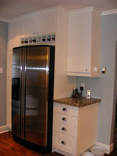 Wine cubbies above fridge extended depth cabinet above for Ikea fridge cabinet