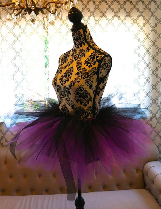 This Ursula like tutu is made with lots and lots of gorgeous tulle and ribbon. It is very adjustable. It will fit most. Include your pant size and ill