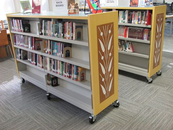 Roll It Over! Mobile shelving helps libraries to open up space - really like the organic end cap detail!