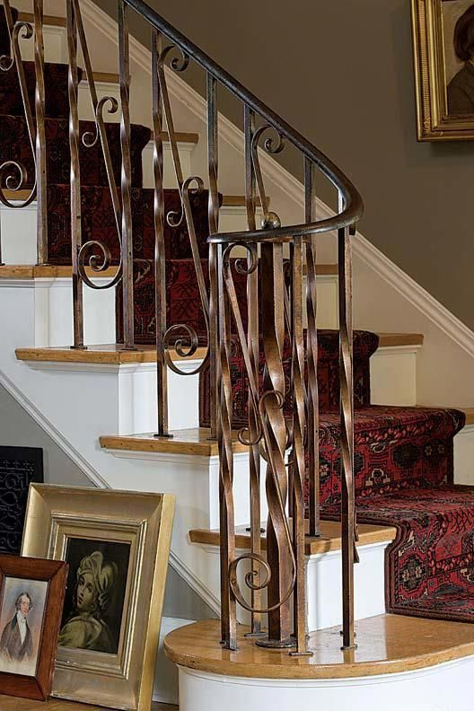 The Staircase Has Gilded Wrought Iron Railings Evo9interior