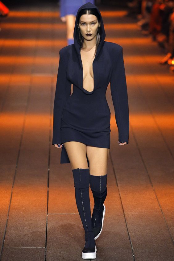DKNY Spring Summer 2017 SS17 Ready-to-Wear collection - New York Fashion Week NYFW - Look 1: Bella Hadid wearing hoddie blue dress and ankle sporty  boots