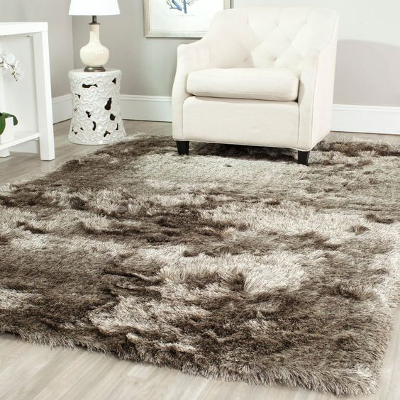 Soft, plush and luxurious, Safavieh's Paris Shag Rug evokes the classic understated elegance and neutral color palette of French Moderne style. The drama of these rugs is in their lush opulent texture.: