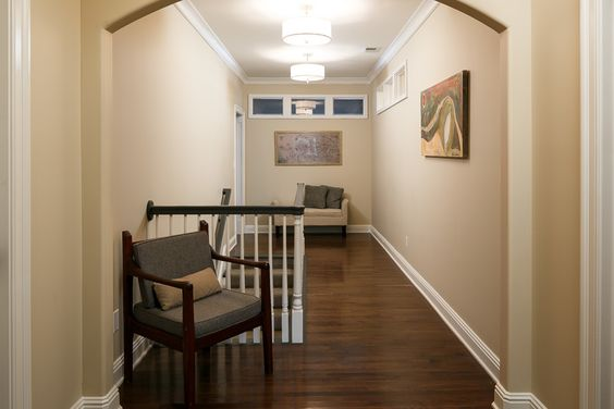 Second floor hallway with curved archways.  Designed and renovated by Ramage Company.