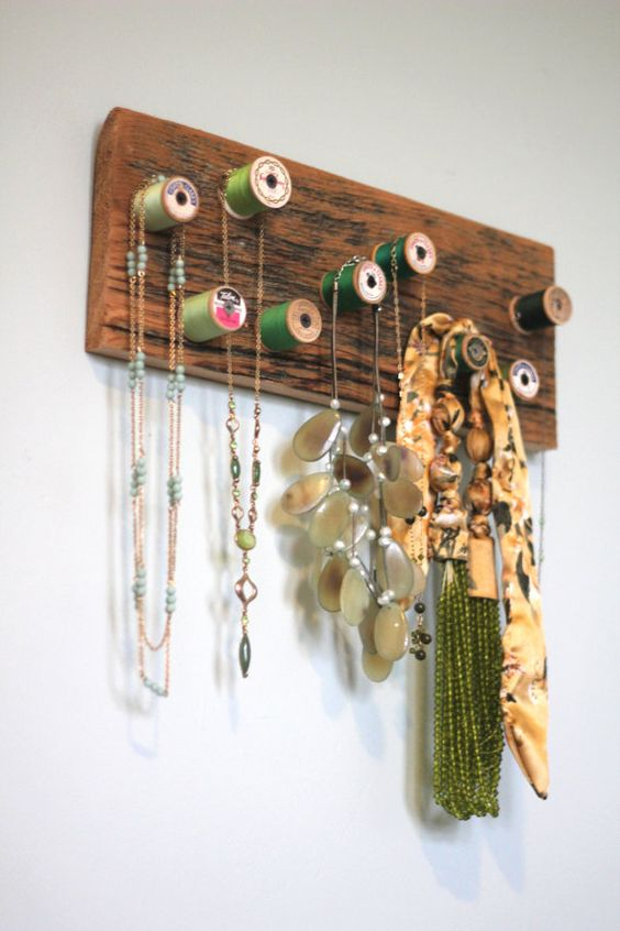 Green and teal wooden thread spool jewelry rack
