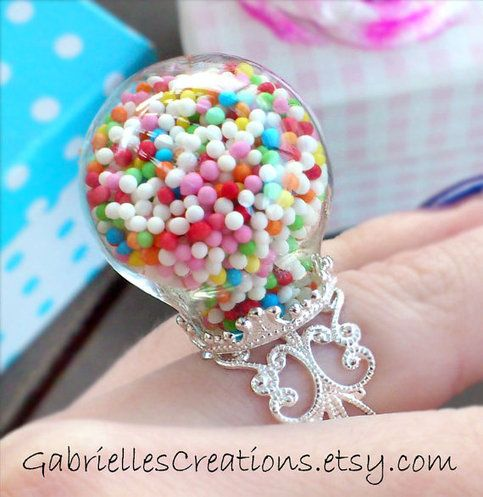#kawaii #miniature #ring Colorful Sprinkles Globe Ring. Holds real candy! ♥ Material: glass, real sprinkles. ♥ Size: approx. 2.5 x 2.5 cm, on a nickel free & lead free silver tone filigree adjustable ring. .*¨*:•..•:*¨ ¨*:•..•:*¨¨*:•..•:*¨¨*:•..•:*¨¨*:•..•:*¨*. Cute Kawaii Jewelry: http://gabriellescreations.s...