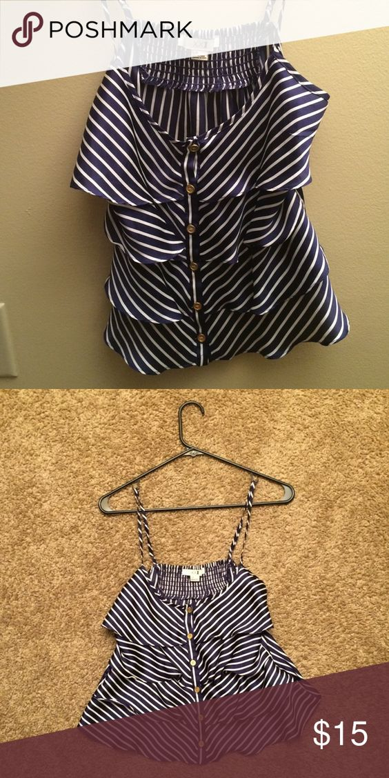 Forever 21 striped ruffle tiered top A cute ruffle tiered striped top from Forever 21. In very good condition, I just grew out of it! Straps are adjustable. Cute with white pants or white shorts. Perfect for 4th of July, day drinking, or just a casual day out! Forever 21 Tops Tank Tops