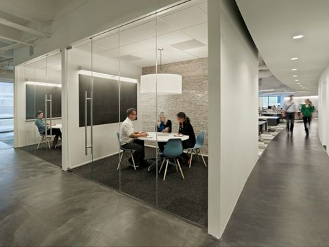Blue Eames Chairs Provide A Splash Of Color In The Cool Interiors Dallas Office TM Advertising