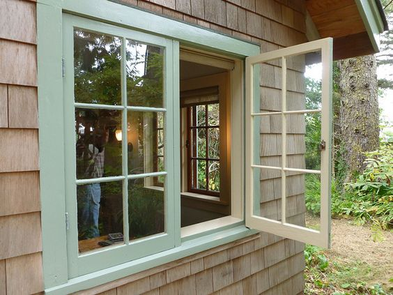 Rehab with wood casement windows and wide sills on the for Wooden casement windows