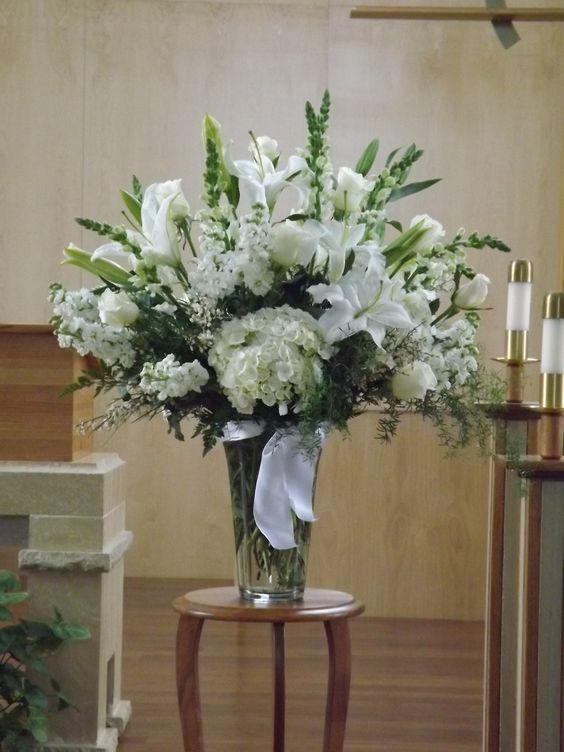 altar piece with white stargazer lilies (Casablanca), white hydrangea, white snapdragons, white stock, white roses, ginestra, springeri