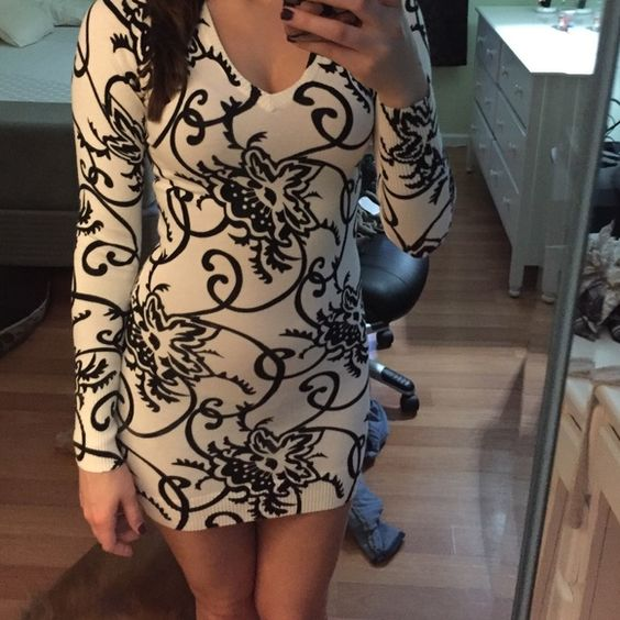 ONE DAY SALE. Black/white lace up sweater dress Black and white patterned sweater dress with black lace up back. never worn! Dresses Mini
