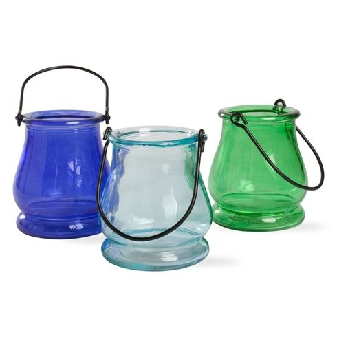 "These pretty little lanterns come in shades of blue and green colors and add a colorful soft light to your outdoor table or patio. Hang them in trees for a great decorative look! Perfect for the beach too! 3.25"" x 3.25"" x 3.75"""