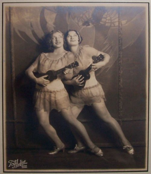 Two girls in costume with ukeleles - 1920's