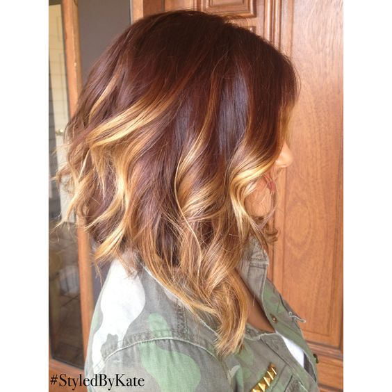 Long bob haircut, slightly A,lined, rich brunette with face framing blonde balayage
