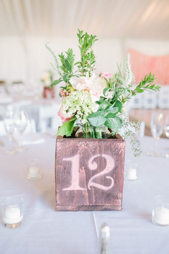diy wooden boxes with spray painted table numbers #centerpiece #tablenumbers #weddingchicks http://www.weddingchicks.com/2014/01/31/vintage-barn-wedding-2/