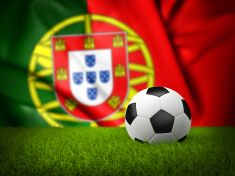 Soccer Field with Ball against Portugal Flag stock photo