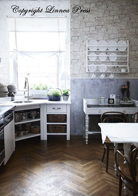 rustic kitchen. Look at that wood floor!