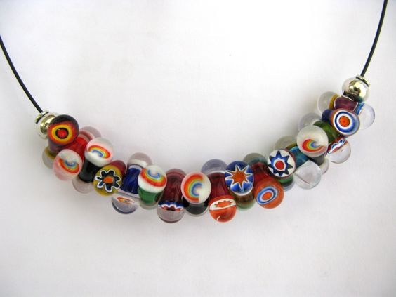 Lampwork beads made by Johan de Lange, with commercial murrini and rainbow murrini made by me.
