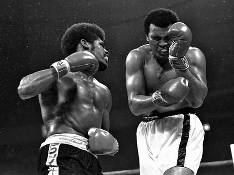 Challenger Muhammad Ali is pictured grimacing after champion Leon Spinks landed a left during their heavyweight title bout at the Superdome in New Orleans, La., Sept. 16, 1978. Ali regained the title with a 15-round unanimous decision.