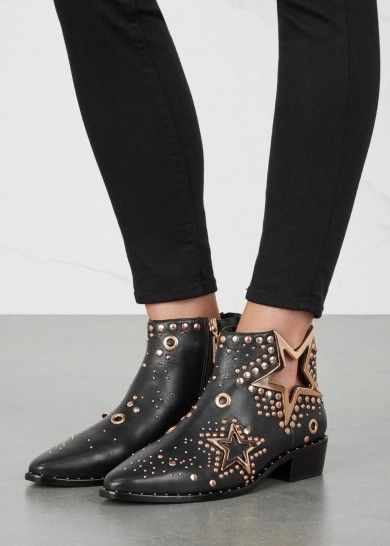 UK exclusive to Harvey Nichols Ivy Kirzhner blackleather ankle boots Heel measures approximately 1.5 inches/ 40mm 18kt rose gold-plated cut-out stars, studs and eyelets, pointed toe Zip fastening at side Come with dust bag