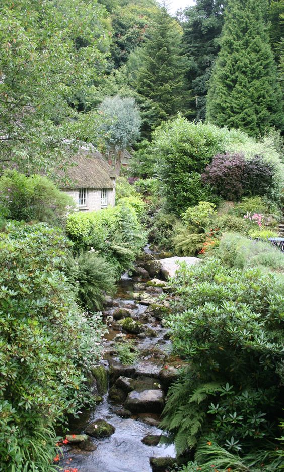 Devon England Thatched cottages and a trickling clear stream. Perfect setting for a cream tea!: