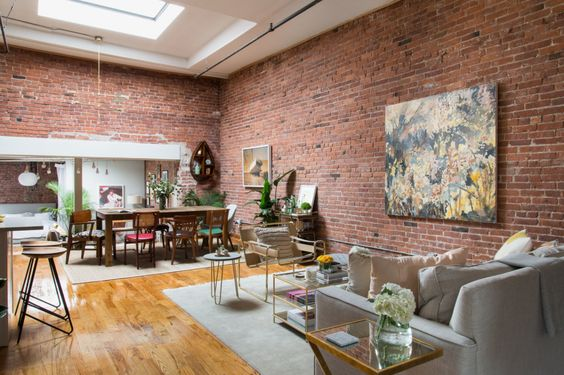 New York loft with exposed brick walls and a skylight