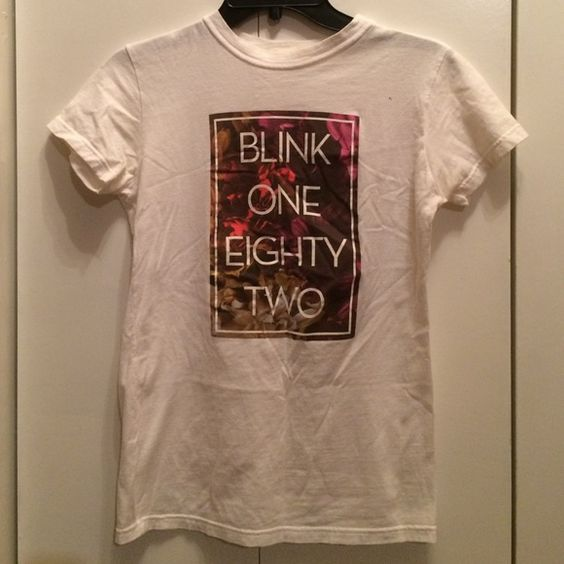 Blink 182 Band T Shirt Blink 182 band tee with floral pattern. Women's medium but it's slim so it fits better as a small. Color has faded but still in good condition! Hot Topic Tops Tees - Short Sleeve