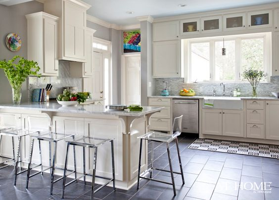 Modern kitchen. Clear dining stools. #zincdoor #acrylic #dining #transitional