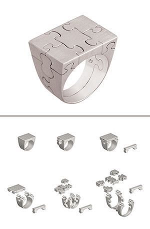Platinum puzzle ring... weird, but in a cool kinda way!