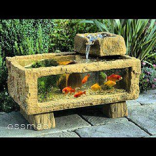 Me gustó este acuario para mi jardín función de fuente y pecera.