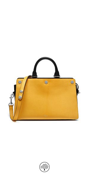 Shop the Chester in Firefly Smooth Calf at Mulberry.com. The Chester, at first glance, has the understated elegance of a vintage style. Its structure is sleek and simple, with two side compartments for keeping your essentials organised. Its versatility as a day bag is enhanced by a removable shoulder strap. For the Winter collection the Chester is introduced in new seasonal brights like this vibrant Firefly version.