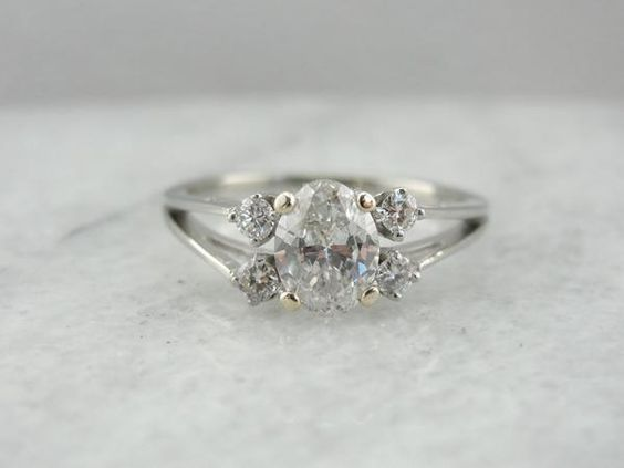 Contemporary and Minimalist: Oval Diamond Engagement Ring with Unusual Profile