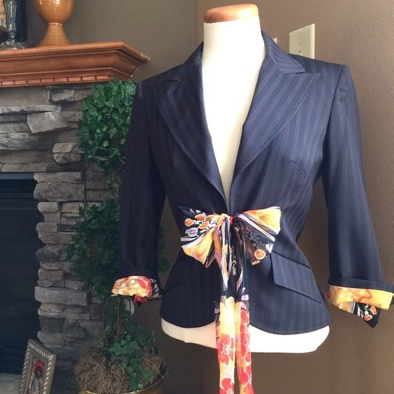 DOLCE & GABBANA 100% Silk Lined Blazer Worn twice and dry-cleaned | Silk Tie Closure | Can Be Worn Cuffed To Display Floral Silk | Designer | Dolce & Gabbana w/ITTIERRA | 100% Silk Floral Lining | Black w/Red & Tan pinstripe | 54% Polyester | 44% Wool | 2% Other Fibers | GORGEOUS | AUTHENTIC | MADE IN ITALY | Just in time for the holidays! Fits right at hips. (fits size 4-8 due to tie closure) Lightly padded shoulders for structure. Dolce & Gabbana Jackets & Coats Blazers
