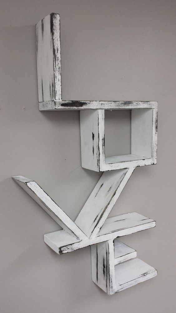 This is a beautiful white distressed love shelf that would look incredible as a prop for a weeding or even to use for wedding or engagement