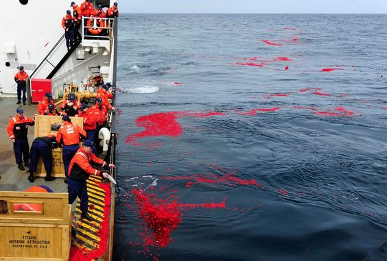 US Coast Guard cutter Juniper crew members lay 1.5 million dried rose petals over the RMS Titanic's resting site in the north Atlantic Ocean