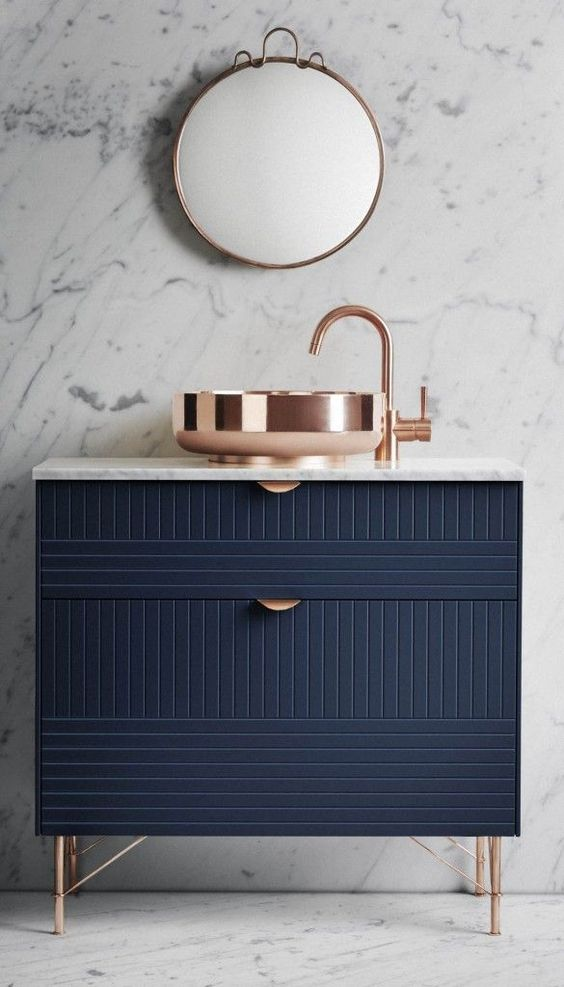 This navy bathroom freestanding cabinet is amazing! Coupled with a contemporary copper sink and tap, simply stunning.