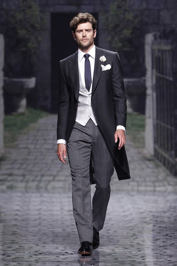Victorio & Lucchino – 2013 Collection. Oliver would look awesome in this.  Grey slacks and black coat