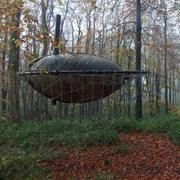 Jesse Randzio and architectural association students create a pod in the woods.