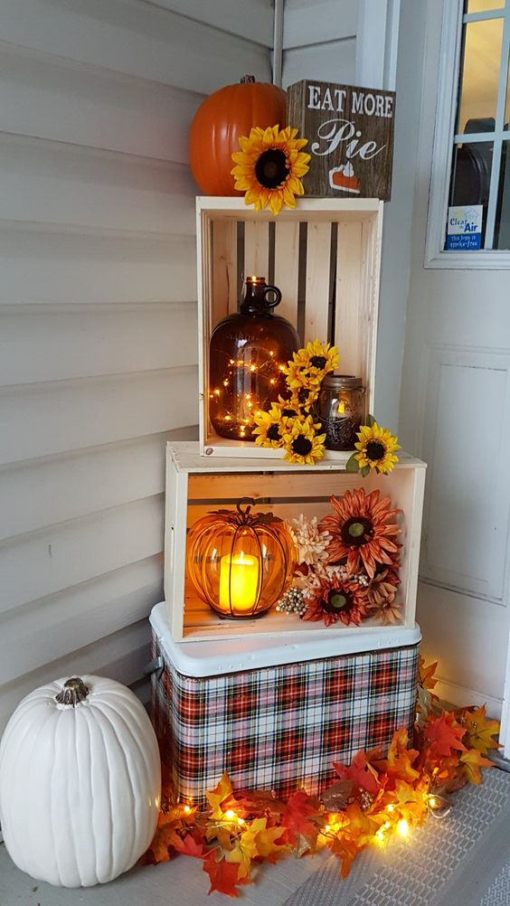 Autumn entry way display crates fall leaves pumpkin plaid cooler old antique jug door display sunflowers string leaves front door front porch display house ideas home