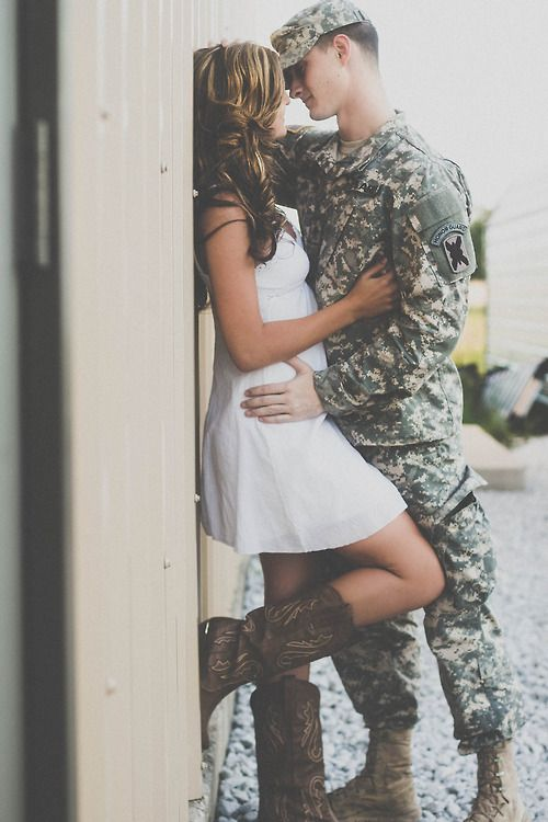This is a beyond adorable picture of you and your army or military boyfriend or husband! So sweet! Great to frame for when you're missing him!! Great engagement photo as well!