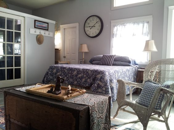 The spacious bedroom area features a queen sized bed with Tempur-pedic topper.
